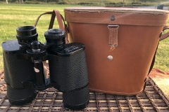 Vintage binocular and its leather case